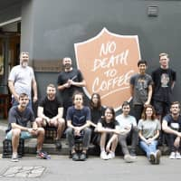 Both feet forward: The assembled staff of Single O's Sydney branch, who are working with the World Coffee Research organization to develop new strains of coffee. | COURTESY OF SINGLE O