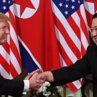US President Donald Trump meets North Korean leader Kim Jong Un in Hanoi on Feb. 27.  On April 1, U.S. Secretary of State Mike Pompeo voiced hope that the two leaders will meet again 'in the coming months' and make significant headway on ending Pyongyang's nuclear program. | AFP-JIJI