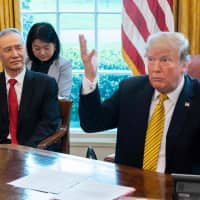 U.S. President Donald Trump speaks during a trade meeting with Chinese Vice Premier Liu He in the White House on April 4. Despite bilateral tensions, a majority of Chinese still hold a favorable view of the United States. | AFP-JIJI