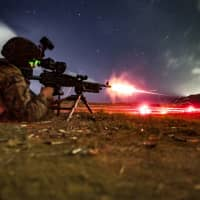 A rifleman with the U.S. 31st Marine Expedition Unit takes part in a live-fire exercise on Guam on March 11. Last month the 31st MEU practiced 'island hopping,' a tactic used by the U.S. in World War II against Japan that is now seen as key to any future war with China. | 31ST MARINE EXPEDITIONARY UNIT