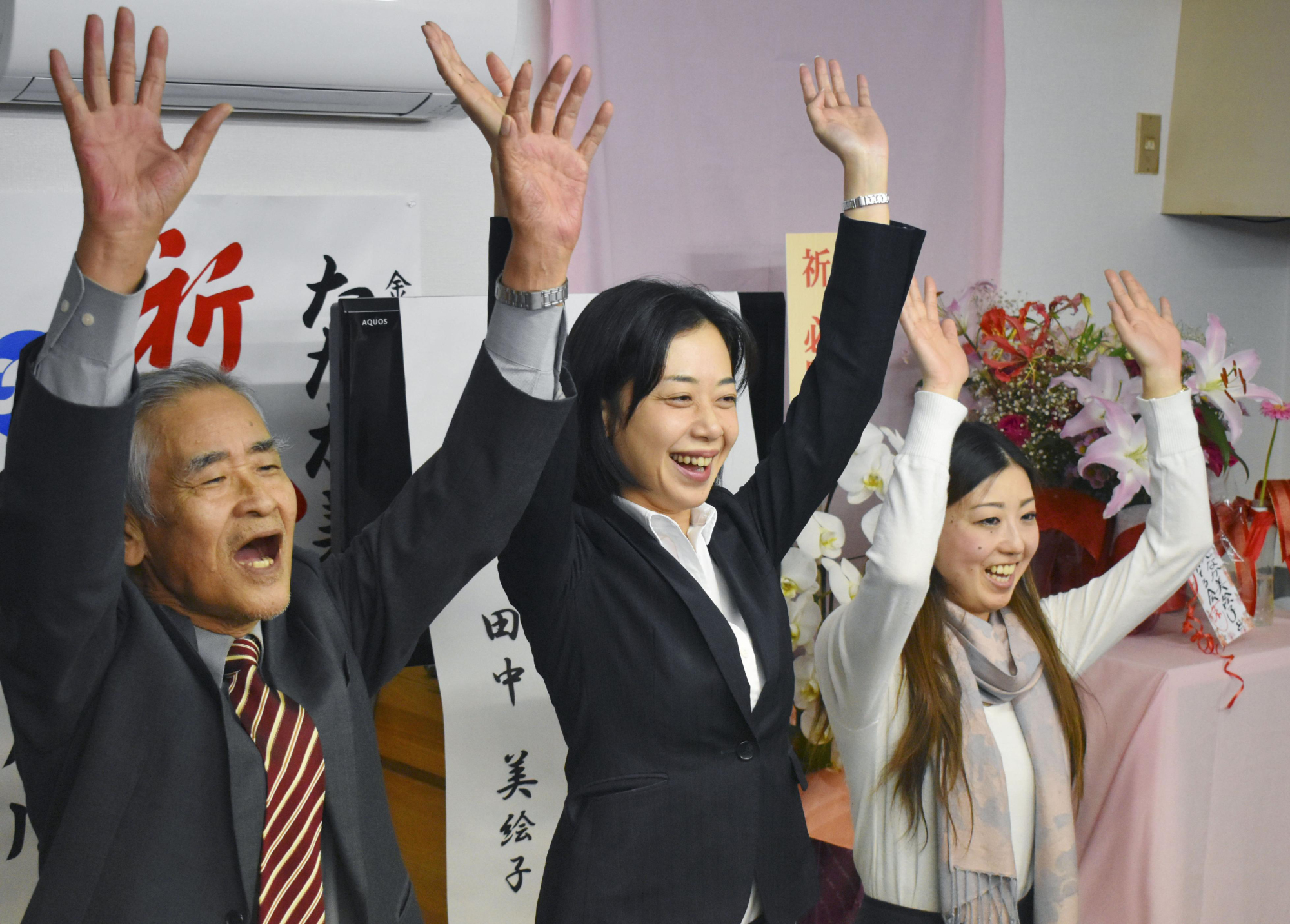 Former Lower House member Mieko Tanaka (center) celebrates with supporters after winning a seat in the Kanazawa Municipal Assembly on Sunday. | KYODO