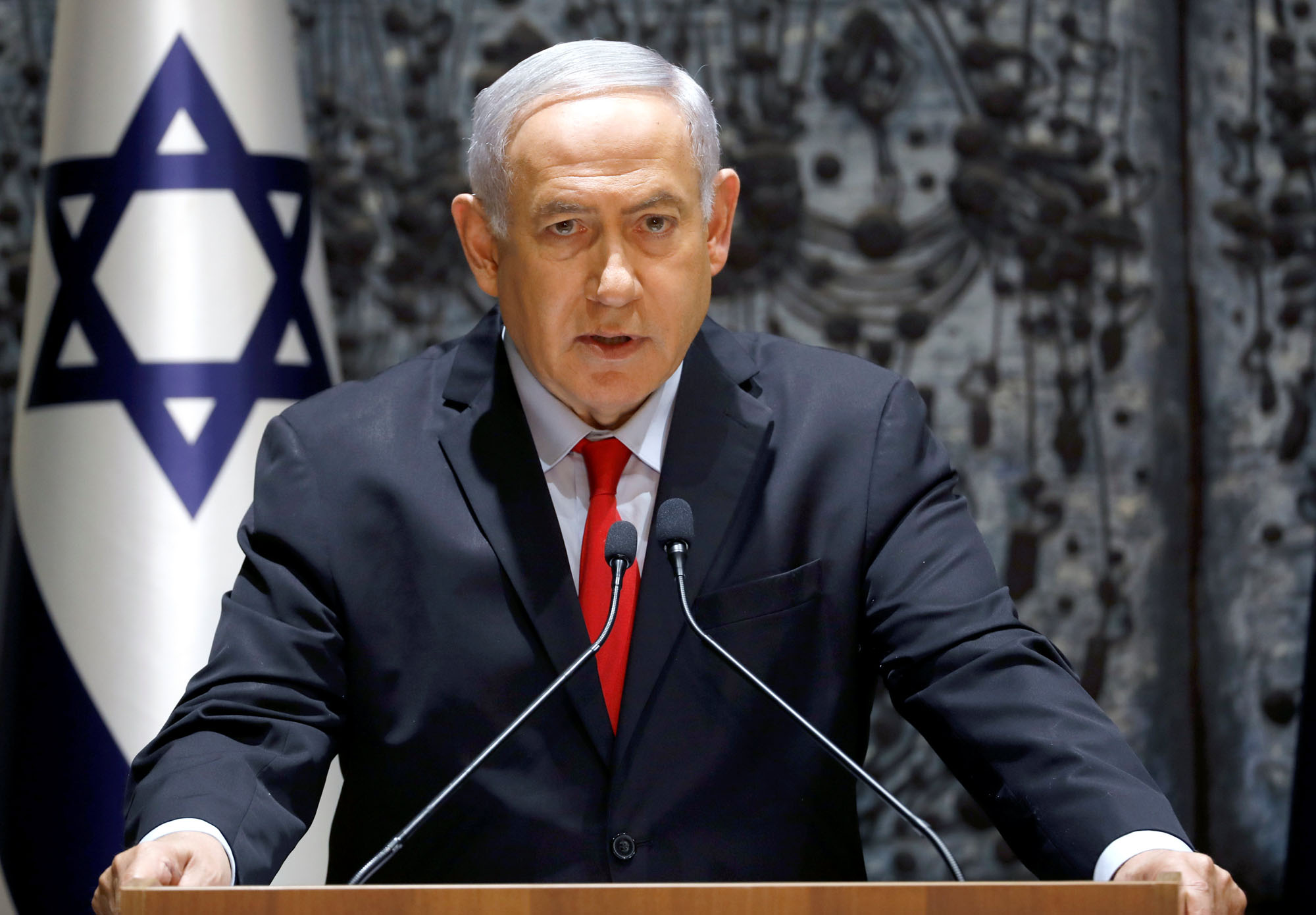 Israeli Prime Minister Benjamin Netanyahu attends a news conference last Wednesday after he was entrusted with forming the next government. | REUTERS