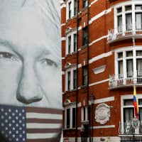 A truck carrying a poster relating to WikiLeaks founder Julian Assange is driven away from the Ecuadorian embassy in London, where Assange is staying. | REUTERS