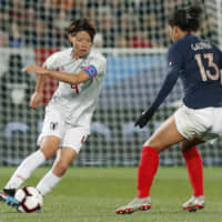 Nadeshiko Japan's Saki Kumagai, seen here against France's Valerie Gauvin during an April friendly, has been named a finalist for BBC's female Footballer of the Year award. | KYODO
