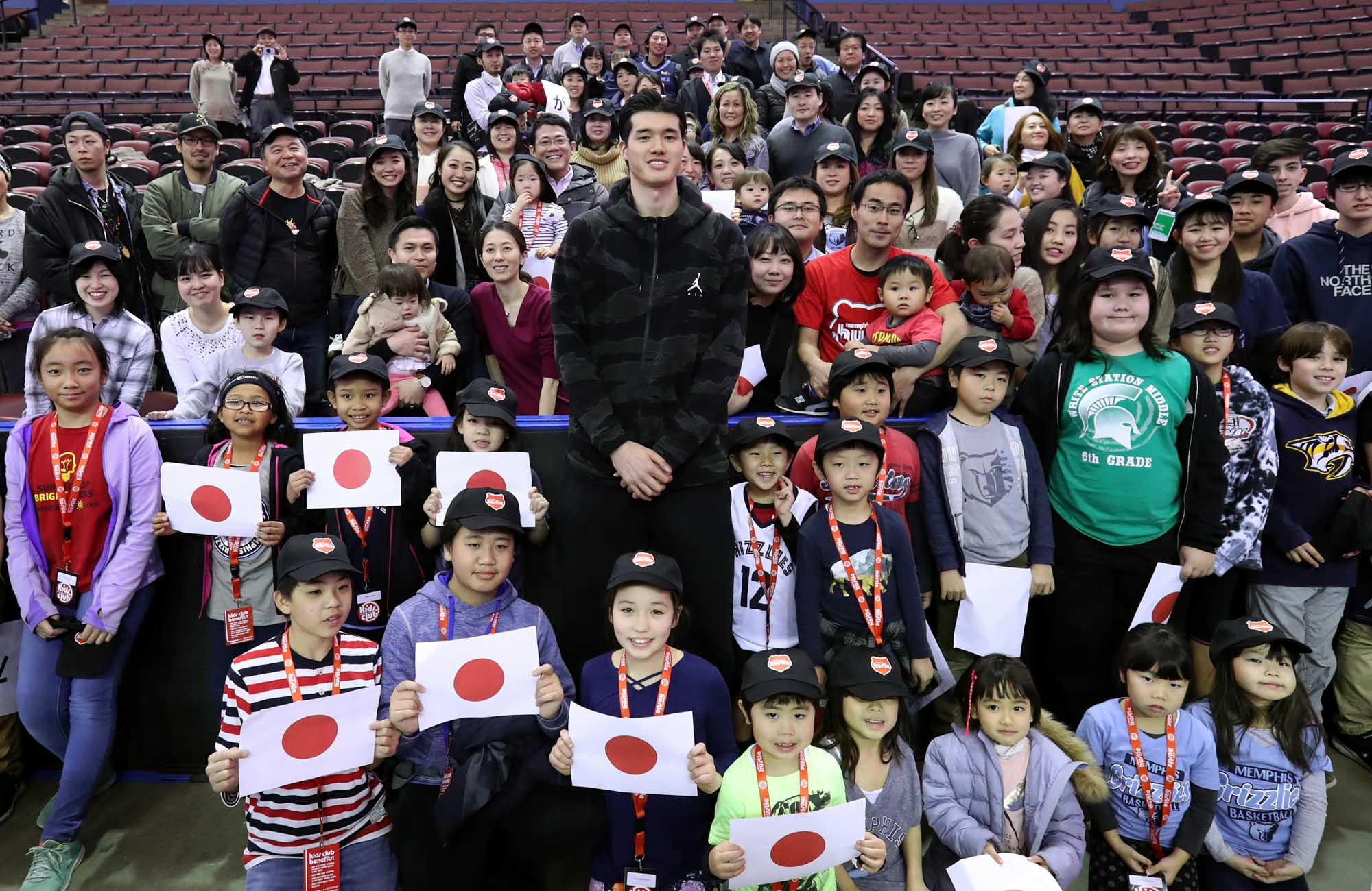 Memphis Grizzlies and Memphis Hustle forward Yuta Watanabe poses with fans before a G League game against the Northern Arizona Suns in February in Southaven, Mississippi. | NBA PHOTOS