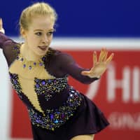 Bradie Tennell of the United States performs her women's free program routine on Saturday. Tennell earned a career-best score of 150.83 points with her second-place finish in the free skate. | AP