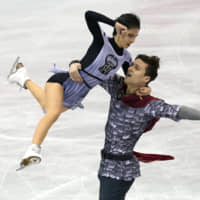 Russia's Natalia Zabiiako and Alexander Enbert compete in the pairs short program on Friday. They placed first in the short program with 75.80 points.   AP