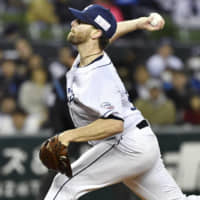 Zach Neal pitches against the Marines during his first start in Japan.   KYODO