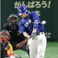 The Dragons' Nobumasa Fukuda whacks a three-run home run in the second inning against the Giants on Tuesday. | KYODO