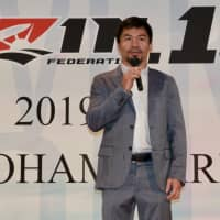 Manny Pacquiao speaks during Saturday's weigh-in for RIZIN 15 in Tokyo.