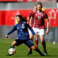 Japan's Emi Nakajima controls the ball in front of Germany's Alexandra Popp during their match on Tuesday in Paderborn, Germany. | REUTERS