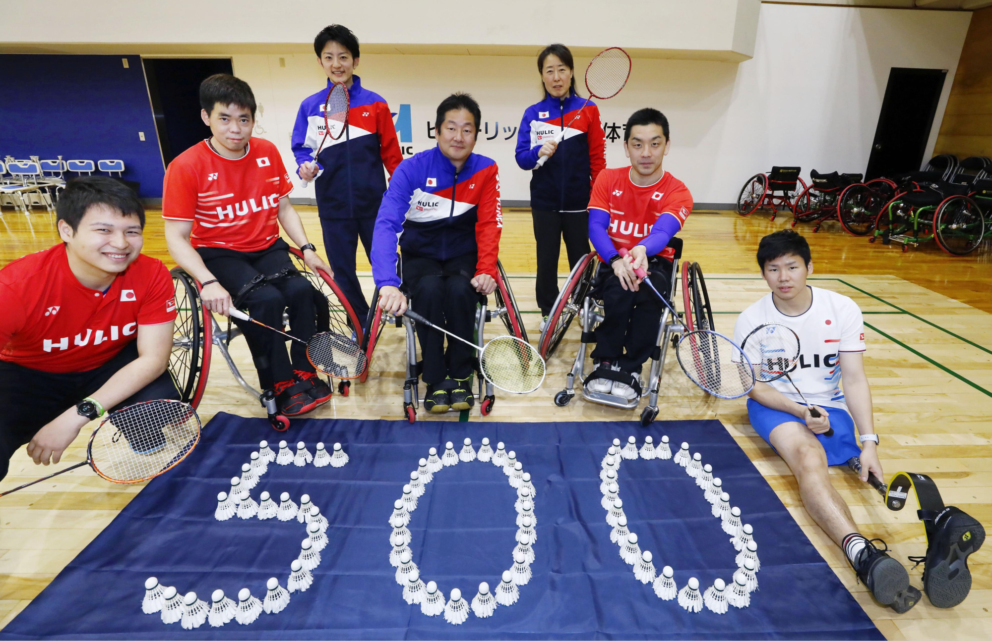 Para-badminton players pose with shuttlecocks placed to read '500' on Friday night in Tokyo's Edogawa Ward. Saturday marked 500 days until the opening of the 2020 Paralympics. | KYODO