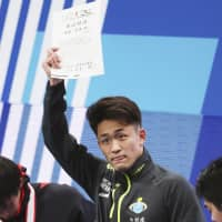 Kengo Ida defends men's 50-meter butterfly national title in record-setting time