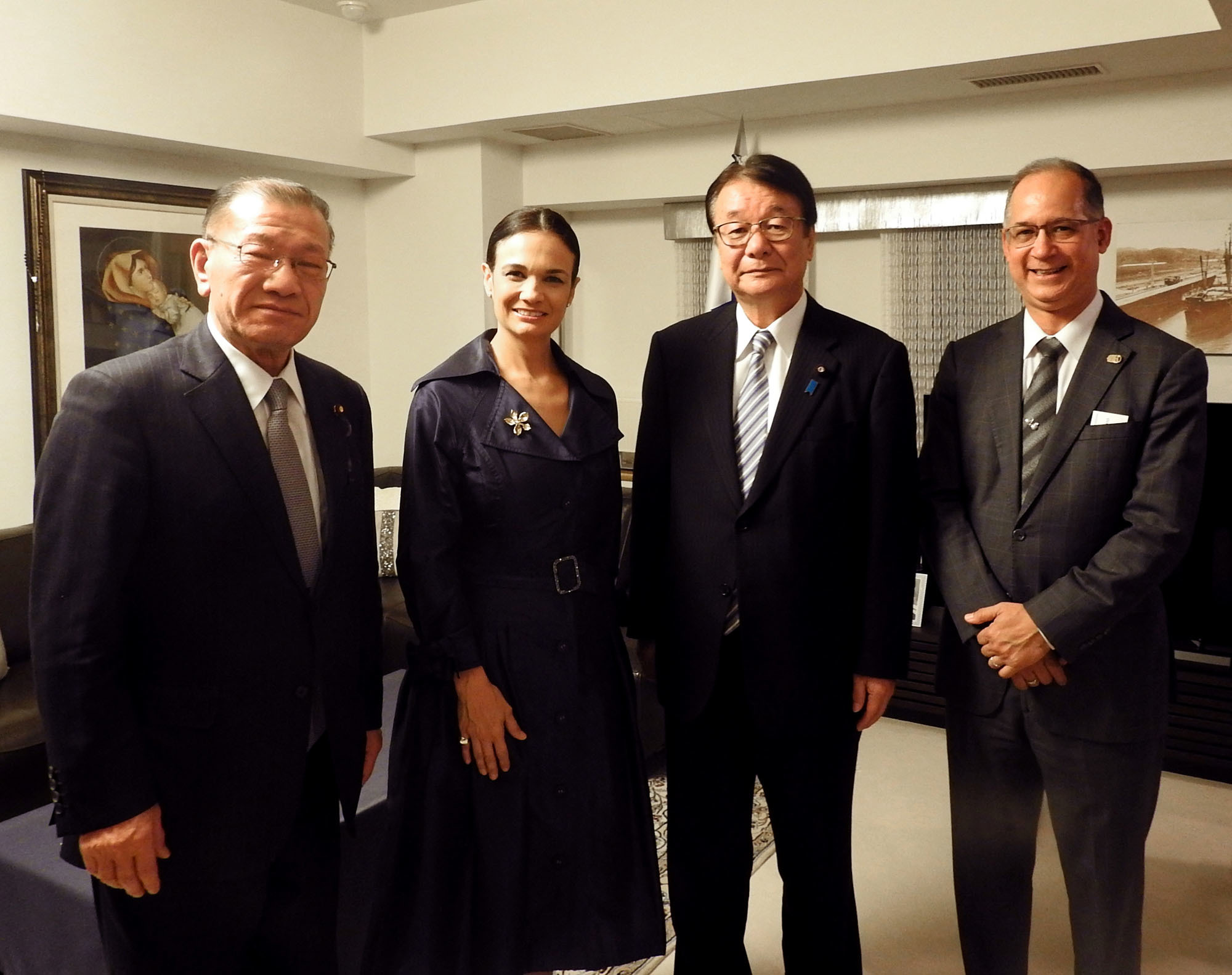 Vice-President and Minister of Foreign Affairs of Panama Isabel De Saint Malo de Alvarado (second from left) poses with (from left) Minister of State for Okinawa and Northern Territories Affairs Mitsuhiro Miyakoshi; National Public Safety Commission Chairman and Minister of State for Disaster Management Junzo Yamamoto; and Panamanian Ambassador Ritter Diaz at a cocktail reception hosted at the ambassador's residence on March 20. |  COURTESY OF THE PANAMA EMBASSY