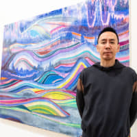 Chinese artist Huang Yuxing in front of his painting 'Qiu mountain.'