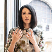 Japanese artist Miwa Komatsu speaks to The Japan Times on May 8 near a window of the Procuratie Vecchie building on Piazza San Marco in Venice, the venue of the group exhibition 'Diversity for Peace!' open through Nov. 24. | TATSUYA AZUMA