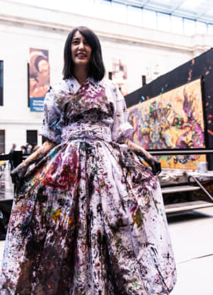 Miwa Komatsu speaks with audience members after her live painting performance at the Cleveland Museum of Art on May 11. | TATSUYA AZUMA