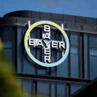 The Bayer AG logo is seen at the headquarters in La Garenne-Colombes, near Paris, Monday. | REUTERS