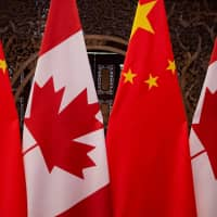 Canadian and Chinese flags are seen prior to a meeting between Canadian Prime Minister Justin Trudeau and Chinese President Xi Jinping at the Diaoyutai State Guesthouse on December 2017 in Beijing. | FRED DUFOUR / POOL / VIA REUTERS