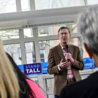 Democratic president candidate and former Colorado Gov. John Hickenlooper speaks at a town hall gathering at Keene State College, in Keene, New Hampshire, Saturday.   KRISTOPHER RADDER / THE BRATTLEBORO REFORMER / VIA AP