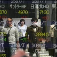 The government downgraded its assessment of Japan's economy in a monthly report released Friday. | AP