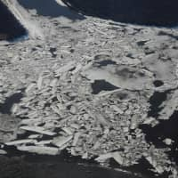 Melting ice on the Kuskokwim River near the town of Bethel on the Yukon Delta in Alaska is seen April 15. According to scientists, Alaska has been warming twice as fast as the global average, with temperatures in February and March shattering records. | AFP-JIJI