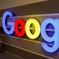 An illuminated Google logo is seen inside an office building in Zurich last December. | REUTERS