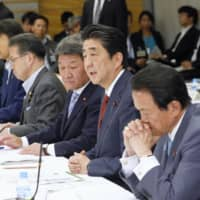 Prime Minister Shinzo Abe discusses future growth policies Wednesday at the prime minister's office. | KYODO