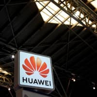A Huawei company logo is seen at the security exhibition in Shanghai Friday. | REUTERS