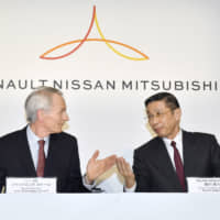 Renault Chairman Jean-Dominique Senard and Nissan CEO Hiroto Saikawa hold a news conference at Nissan's headquarters in Yokohama in March. | KYODO