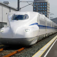 The new N700S model for the Tokaido Shinkansen line is unveiled to the media during a test run at Central Japan Railway Co.'s rail yard in Hamamatsu, Shizuoka Prefecture, in October 2018. | KYODO