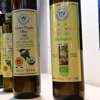 Bottles of Sicily produced organic olive oil are displayed on Wednesday at the TUTTOFOOD fair, the international B2B show dedicated to food and beverage and organized by Fiera Milano from 6th to 9th may 2019, in Milan, Italy. | AFP-JIJI