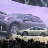 Subaru Corp. introduces the latest model of its Outback crossover sport utility vehicle on April 17 at a press preview for the New York International Auto Show. | KYODO
