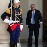 European Commission President Jean-Claude Juncker leaves after meeting with French President Emmanuel Macron and other state leaders for the 'Christchurch Appeal' against terrorism, at the Elysee Palace in Paris Wednesday. | REUTERS
