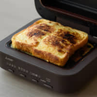 French toast is made with a Mitsubishi Electric Corp. Bread Oven during a demonstration in Tokyo last month. | BLOOMBERG