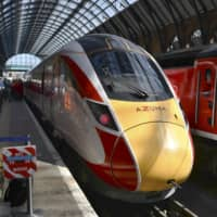 The Azuma high-speed train, manufactured by Japan's Hitachi Ltd., is shown to the media at London's King's Cross Station on Tuesday. The train was to begin commercial operations from Wednesday.   KYODO
