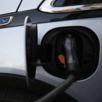 Drivers of electric vehicles, including the Chevrolet Bolt, are being hit with higher fees in 24 U.S. states. | BLOOMBERG