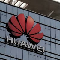 The Huawei logo is pictured outside Huawei's factory campus in Dongguan, Guangdong province, China, March 25. | REUTERS