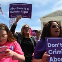 Abortion rights activists rally in front of the U.S. Supreme Court in Washington Tuesday. — Demonstrations were planned across the U.S. on Tuesday in defense of abortion rights, which activists see as increasingly under attack. The 'Day of Action' rallies come after Alabama passed the country's most restrictive abortion ban, prohibiting the procedure in all cases, even rape and incest, unless the mother's life is at risk. | AFP-JIJI