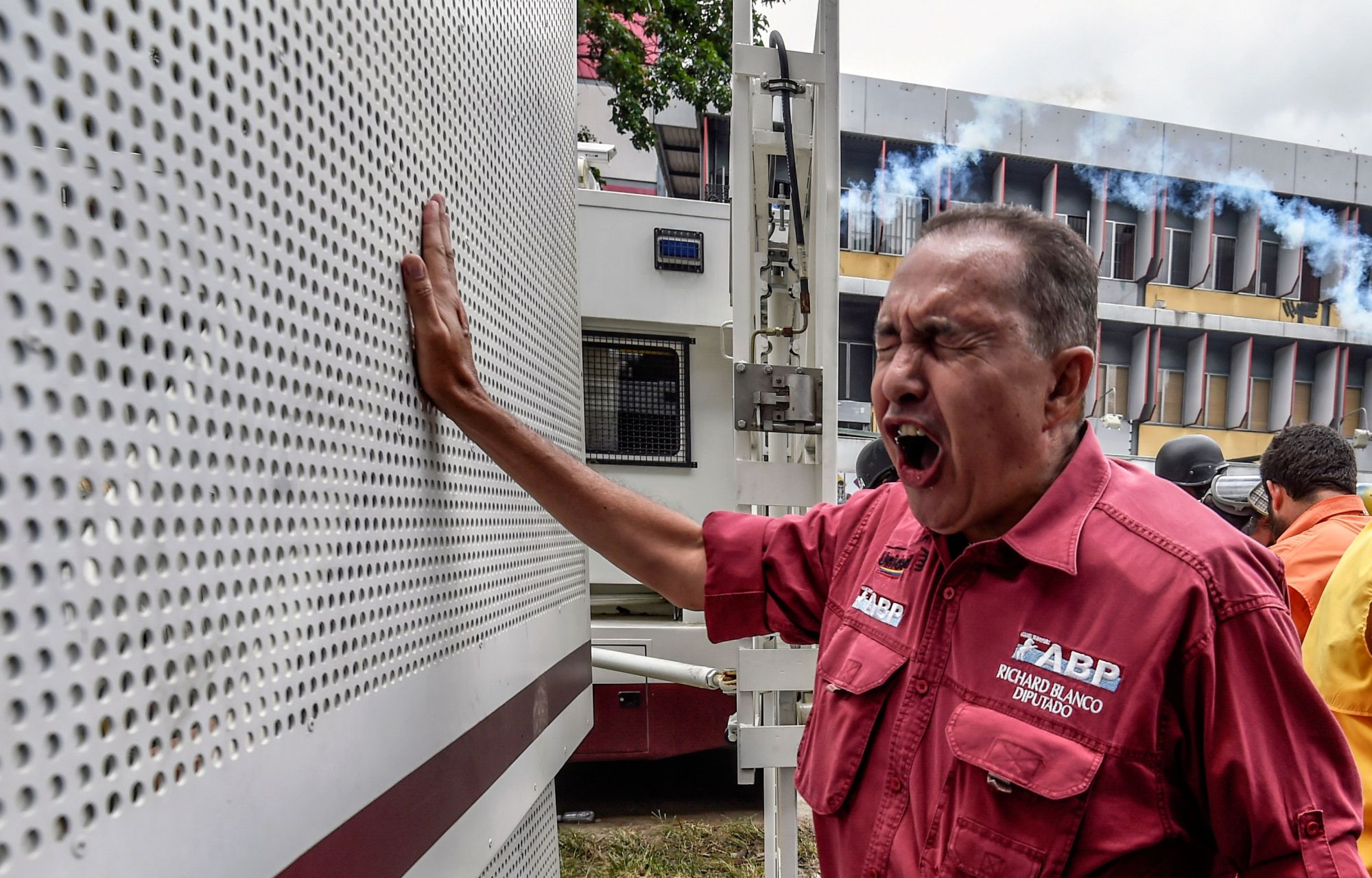 Venezuelan opposition deputy Richard Blanco confronts a national guard's truck during a protest over President Nicolas Maduro's government in Caracas in 2017. Blanco, one of 10 Venezuelan legislators accused of supporting a military uprising against Venezuelan President Nicolas Maduro, took refuge in the Argentine ambassador's residence in Caracas to prevent his detention, he announced on Thursday. | AFP-JIJI