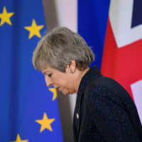 British Prime Minister Theresa May leaves after giving a news briefing in Brussels, Belgium, on March 22. | REUTERS