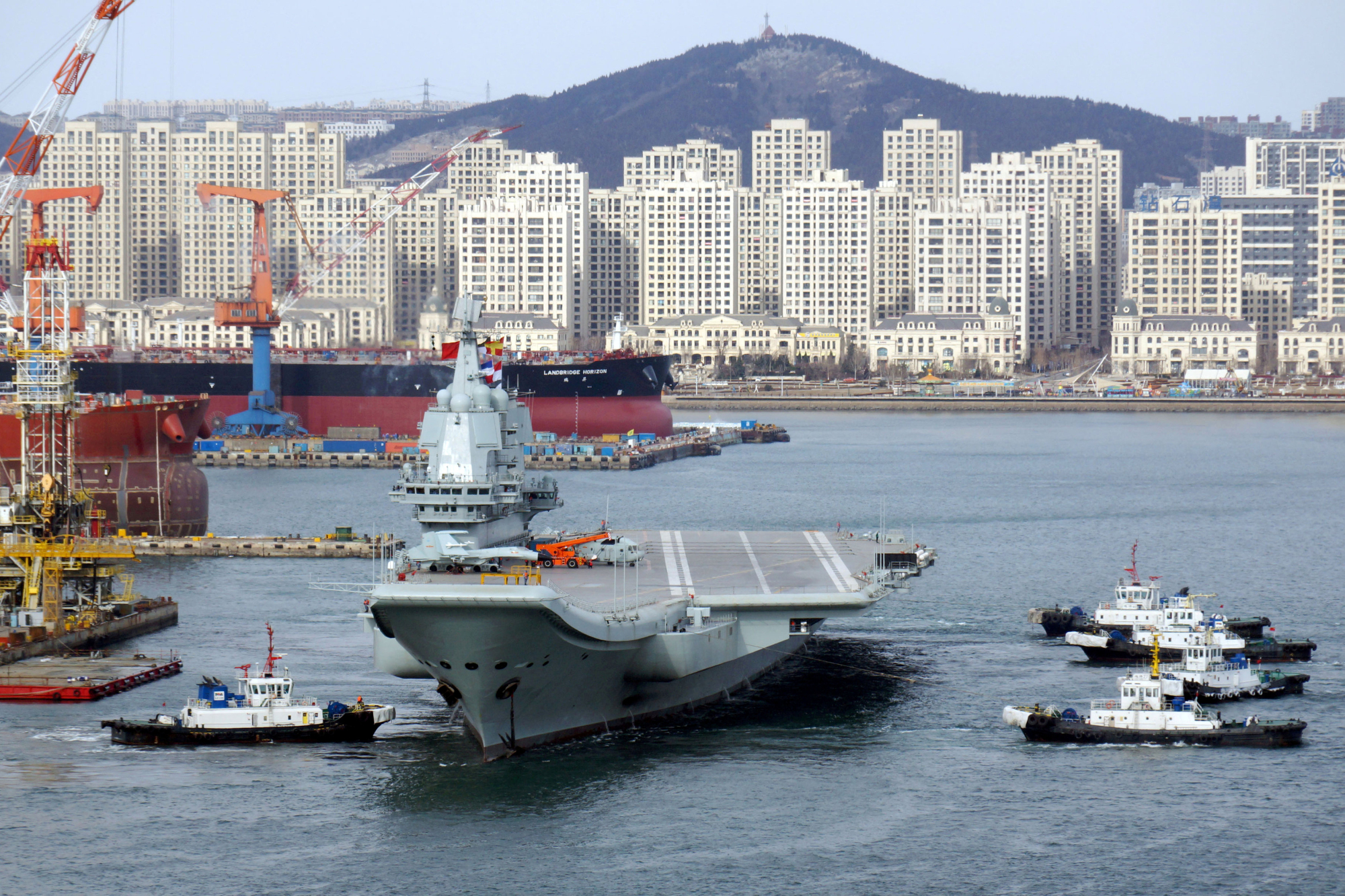 China's first domestically developed aircraft carrier sails from Dalian, Liaoning province, for its fourth sea trial in December 2018. | REUTERS
