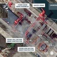 A satellite image from April 17 shows what appears to be the construction of a third Chinese aircraft carrier at the Jiangnan Shipyard in Shanghai. | REUTERS