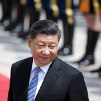 Chinese President Xi Jinping attends a welcoming ceremony for Greek President Prokopis Pavlopoulos outside the Great Hall of the People in Beijing on May 14. | REUTERS