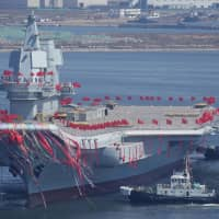 China's first domestically built aircraft carrier is seen during its launch ceremony in Dalian, in the country's Liaoning province, in 2017. | REUTERS