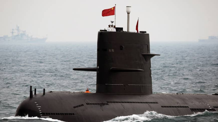 A Chinese Navy submarine takes part in an international fleet review to celebrate the 60th anniversary of the founding of the People