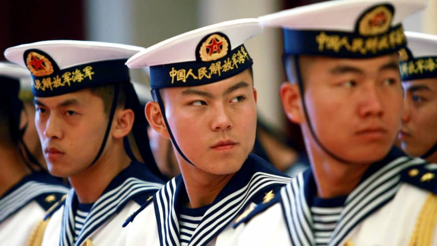 A military honor guard prepares to welcome then-U.S. Chief of Naval Operations Adm. Jonathan Greenert at the headquarters of the Chinese People