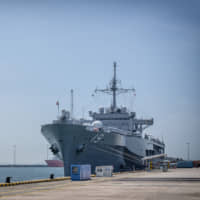 The U.S. Navy's USS Blue Ridge sits anchored in Singapore on Thursday. The Japan-based Blue Ridge is the flagship of the 7th Fleet and the oldest operational ship in the U.S. Navy. | BLOOMBERG