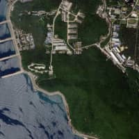 A satellite image shows docked vessels at the Chinese military's Yulin Naval Base in Yalong Bay, Hainan Province, last September. | REUTERS
