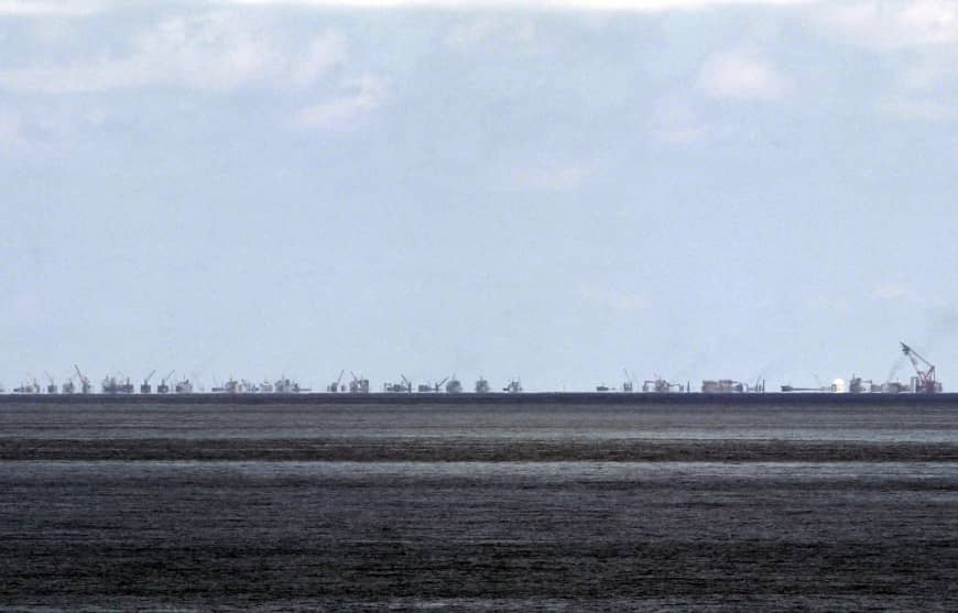 Land reclamation is seen at Chinese-held Subi Reef in the Spratly chain of the South China Sea from the Philippines